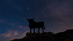 Night Sky Star Timelapse and Black Bull in Spain Stock Footage
