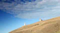 Lighthouse. The movement of clouds on the mountain Meganom, Crimea, Russia Stock Footage