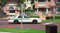 Police Car Drives Down Brick Road Luxury Condos Plane Car Site HD HD Footage