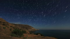Night landscape, night sky with moving stars over the sea. Mountain Meganom Stock Footage