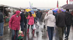 Cold wet rainy day at the farmers market in St Jacobs Ontario - stock footage