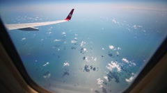 Panorama of clouds seen through the airplane window Stock Footage