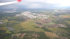 Small towns and city under airplane wing, aerial view Stock Footage