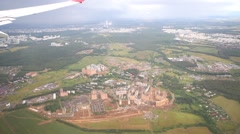 Constructing Small town surounded by forest, aerial view Stock Footage
