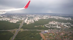 Huge traffic near big city viewed from airplane window Stock Footage
