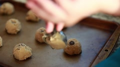 Mother baking cookies with toddler Stock Footage