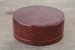Antique lacquer wares on wooden table Stock Photos