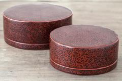 antique lacquer wares on wooden table - stock photo