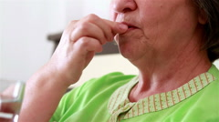 Close up of senior woman taking a pill Stock Footage