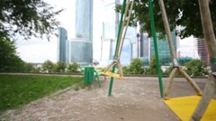 Swings near skyscrapers of Moscow City in Moscow Stock Footage