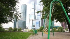 Swings near business complex Moscow City in Moscow Stock Footage
