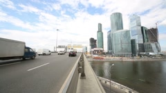 Cars on bridge and skyscrapers of Moscow City business complex Stock Footage