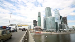 Moving cars on bridge and Moscow City business complex Stock Footage