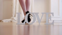 female legs in stockings and high-heeled shoes and word Love - stock footage