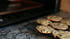 Hot cookies on the cooling rack Stock Footage