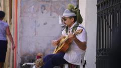 Cuba, La Habana vieja, Old Havana, man playing guitar Stock Footage