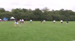 Ultimate frisbee game in light rain in Toronto park Stock Footage