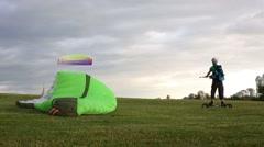 Sportsman in helmet engages landkiting in park on Poklonnaya Hill Stock Footage