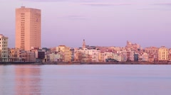 Cuba, Havana, Malecon promeade, Caribbean sea, buildings, skyline at sunset Stock Footage