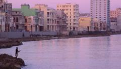 Cuba, La Habana, Havana, city, Malecon promenade, people fishing Stock Footage