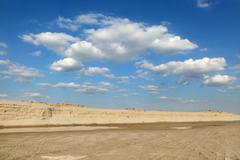 sand exploiting , landscape with beautiful sky - stock photo