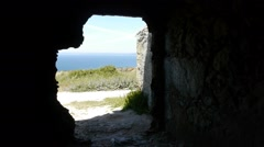 View of the sea from a dark ruin Stock Footage