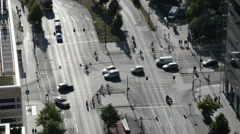 cars driving at crossroads. multi lane traffic in a city. - stock footage