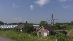 River dike to river Waal + pan Varik village with greenhouses and windmill. Stock Footage