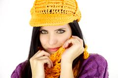 beautiful woman with hat and scarf smiling - stock photo
