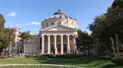 Bucharest athaeneum building, birds flying around, spring atmosphere Stock Footage
