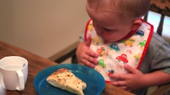 Little boy eating pizza Stock Footage