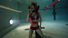 Female scuba diver in the pool Stock Footage