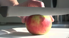 Cutting an apple slowmotion dept of field Stock Footage