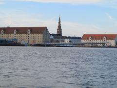 copenhagen, denmark : canals, tower of vor frelsers kirke on august 6, 2013 - stock photo