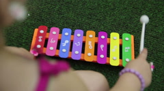 Girl play on xylophone Stock Footage
