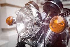 Close up of a motorcycle headlight with blinker light Stock Photos
