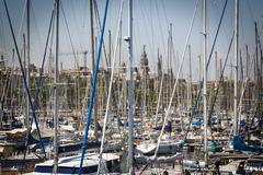 A huge wood of vessel masts in the harbor of barcelona, spain Stock Photos