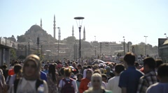 People walking with the Suleymaniye Mosque in background Stock Footage