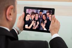 businessman listening karaoke on digital tablet - stock photo