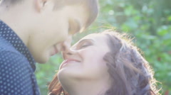Happy young couple in love at the park - stock footage