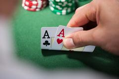 Man with two aces in casino Stock Photos