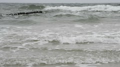 Beach of the Baltic Sea with rough weather Stock Footage