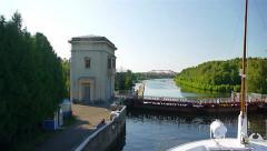 Transport ship boat runs through gateway on Volga river Stock Footage