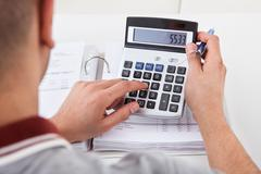 Man calculating financial expenses Stock Photos