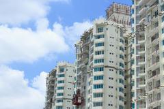 Real estate condominium building blue sky Stock Photos