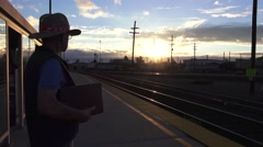 Train depot, sun flare and shinny tracks Stock Footage