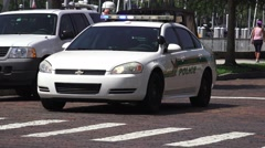 Police Car Flashing Lights Daytime Brick Road 4K Stock Footage