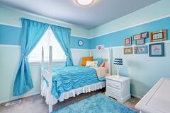 Charming girls room interior in blue tones Stock Photos