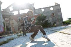 energetic young hip hop street dancer - stock photo