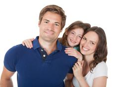 portrait of affectionate family against white background - stock photo